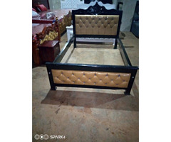 Five by six leather bed.