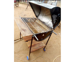 Charcoal grilling machine